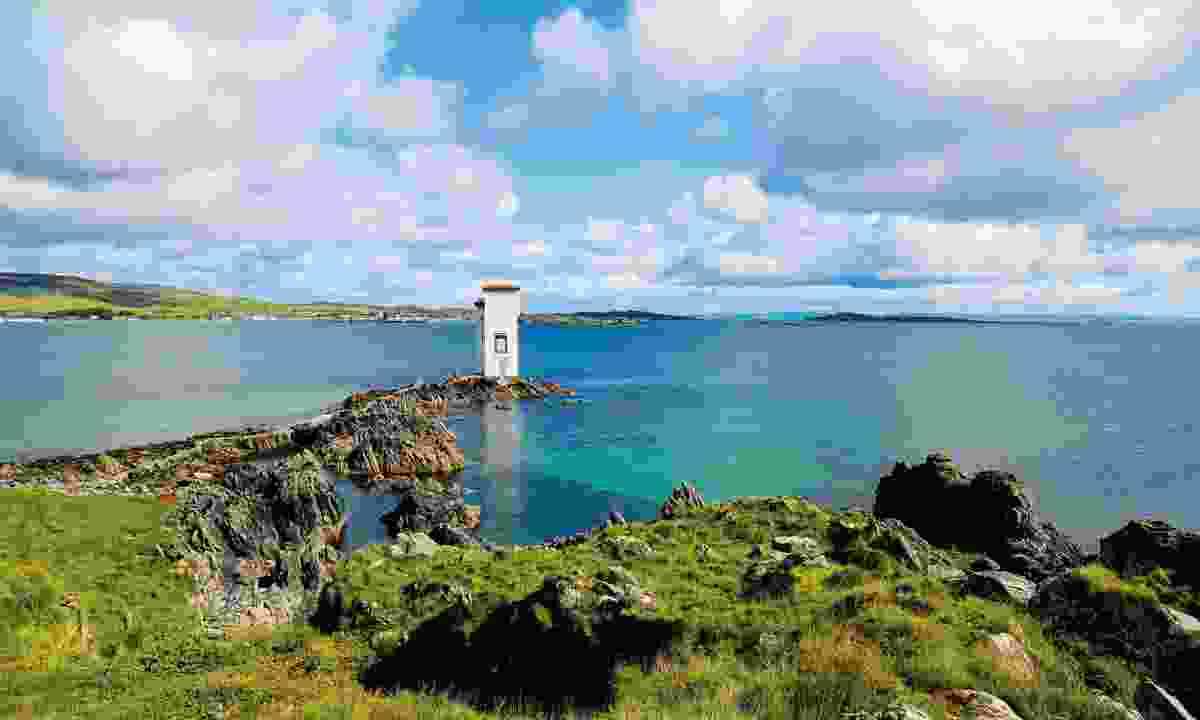 The white Port Ellen lighthouse on the south coast of Islay (Graeme Green)