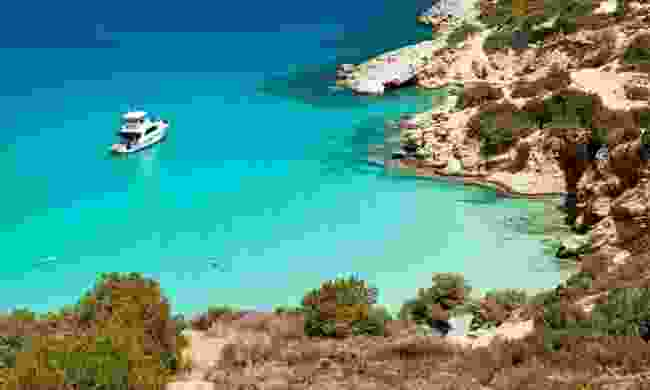 Boat anchored in the bay at Crete, Greece (Shutterstock)