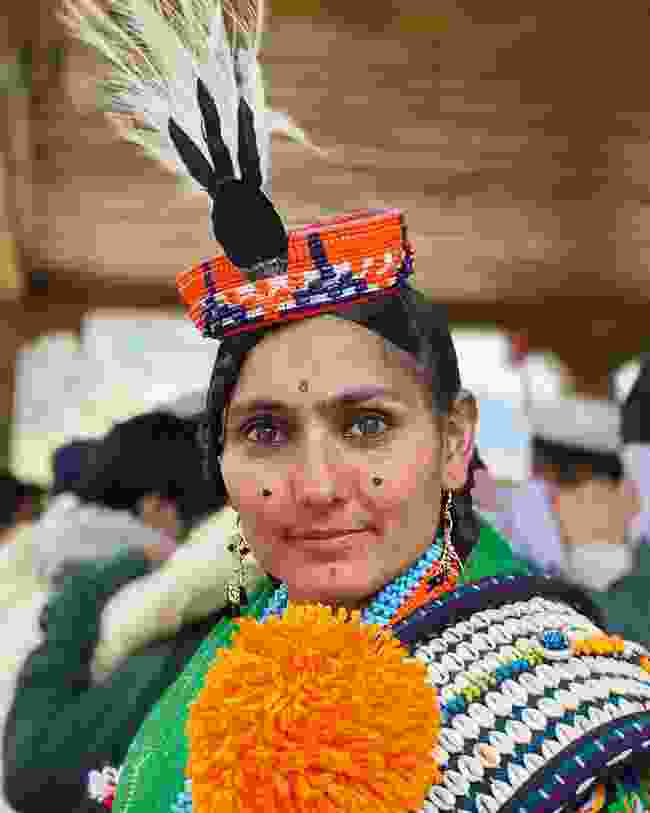 A Kalash woman wearing piran and a feather headdress  (Emma Thomson)