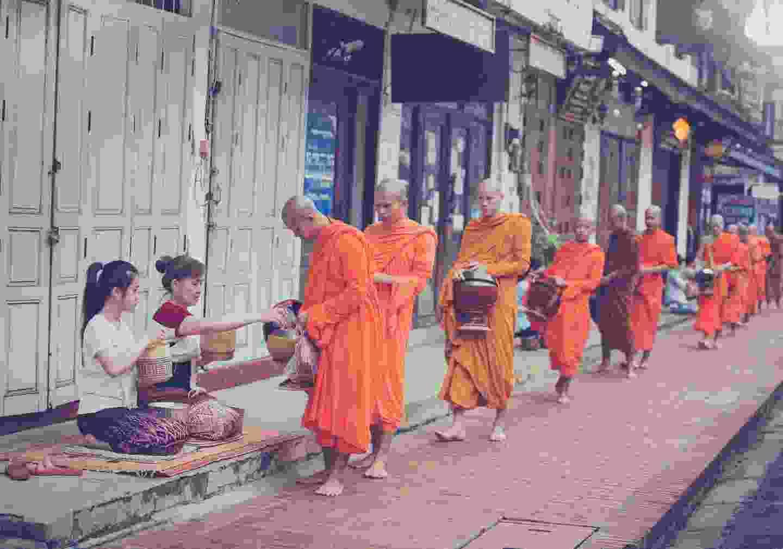 Monks receiving alms in Luang Prabang (Shutterstock)