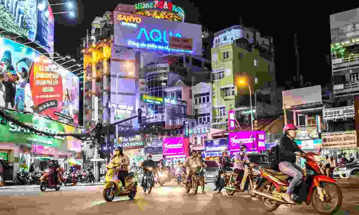 Explore downtown Ho Chi Minh City (Saigon) at night on a Vespa, Vietnam (Shutterstock)