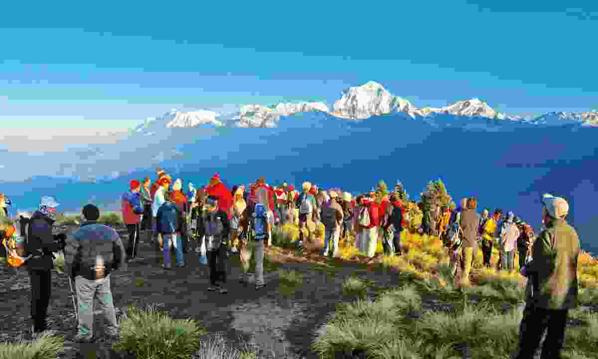 Tourists meet the sunrise at the top of Poon Hill in the Himalayas, Nepal (Dreamstime)