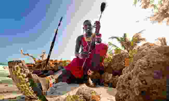 Maasai warrior on the beach (Shutterstock)