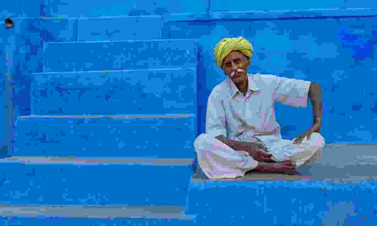 Local man sitting on a step in Jodhpur (Shutterstock)