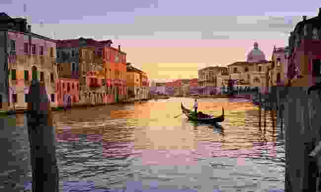 Gondola ride at sunset in Venice (Dreamstime)