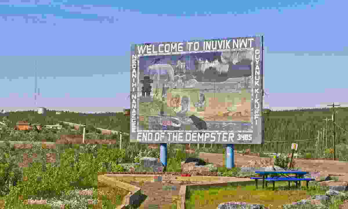 The artistic 'Welcome to Inuvik' sign at the end of the Dempster Highway (Dreamstime)