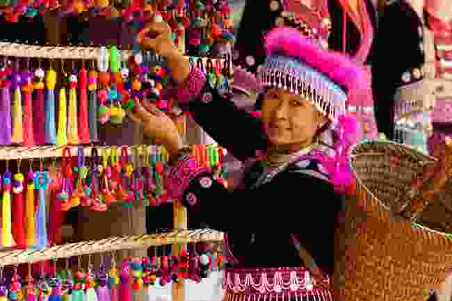 A Hmong women with locally-made souvenirs, northern Thailand (Shutterstock)