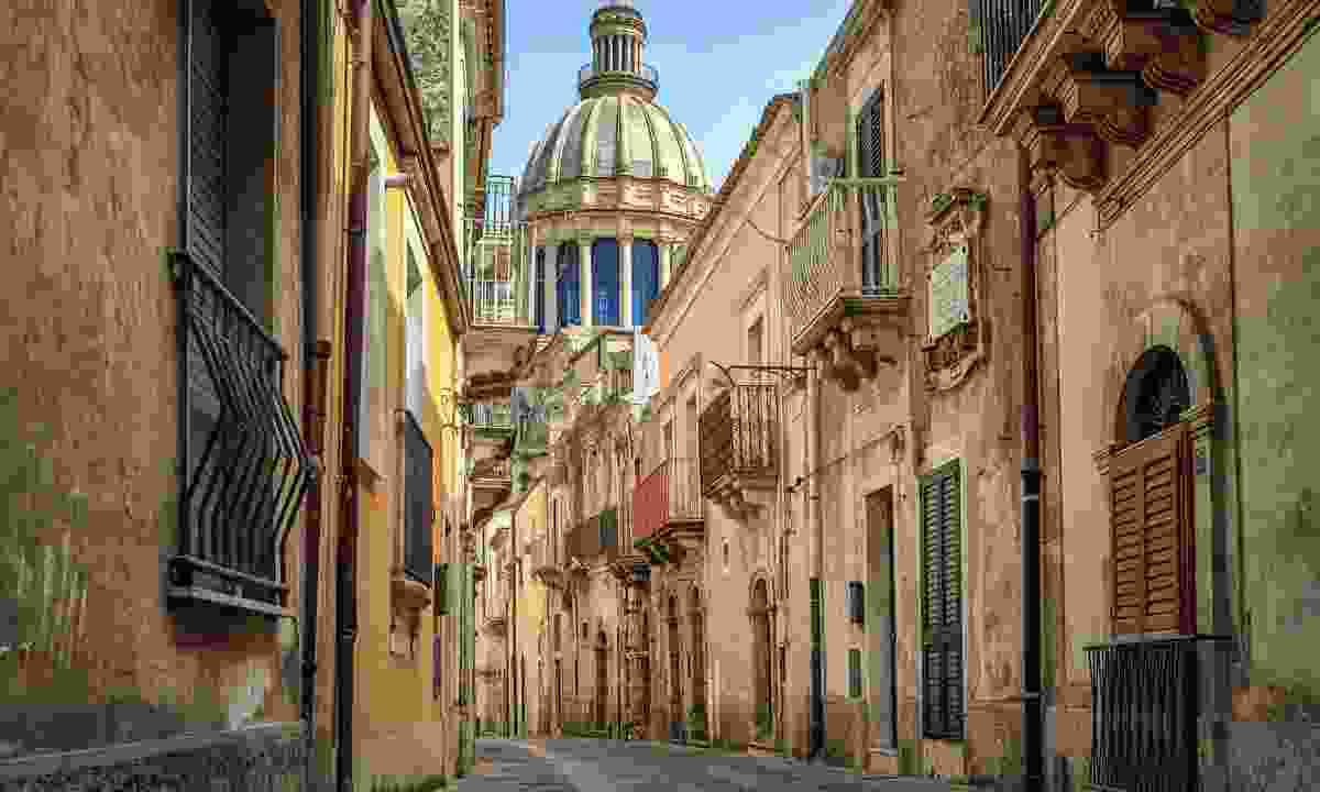 Narrow street in Ragusa, Sicily (Dreamstime)