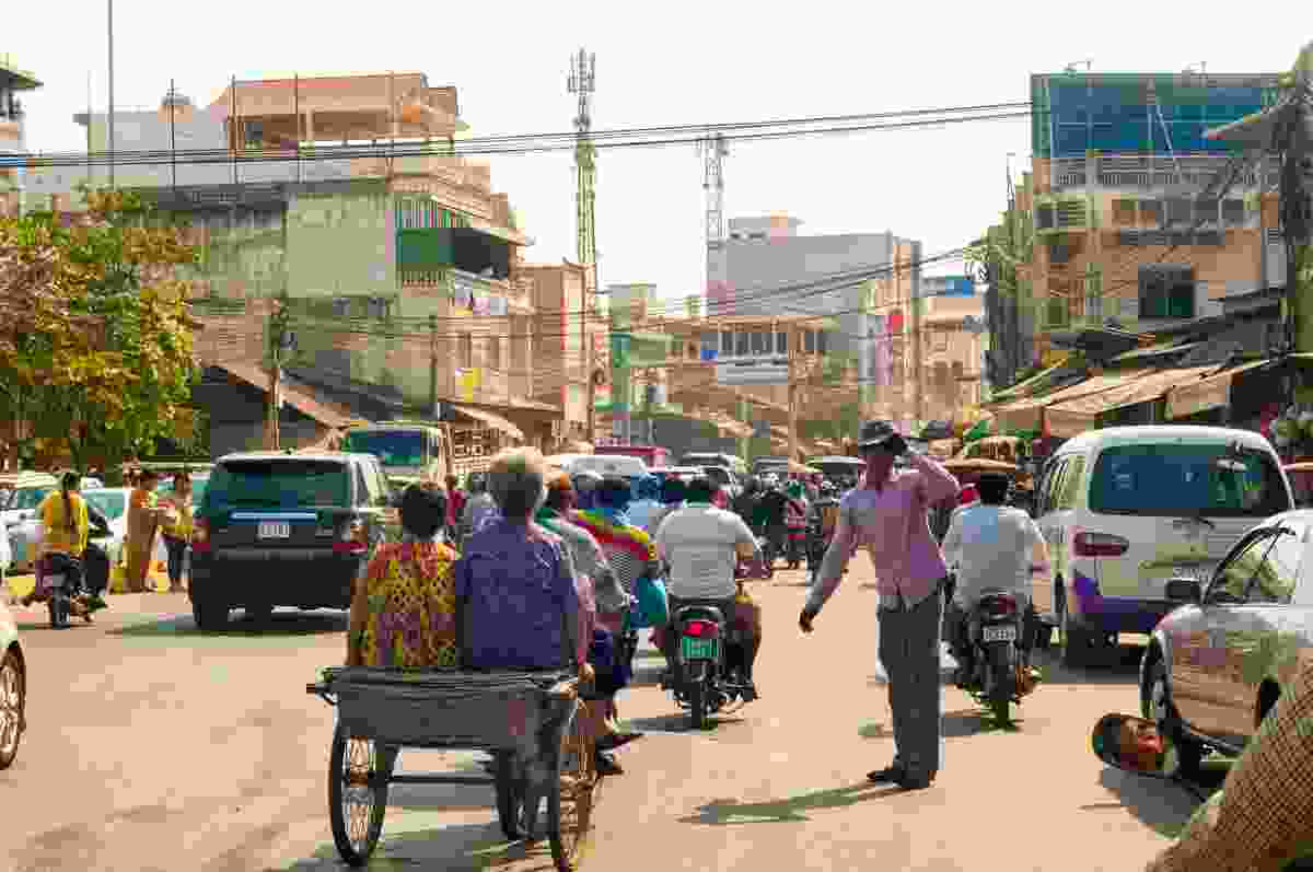 Locals battle the traffic on a main road in Phnom Penh, Cambodia (Dreamstime)