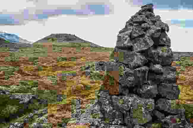 A cairn sits on the rugged Neshruan lava field, where caves await visitors (Mark Stratton)
