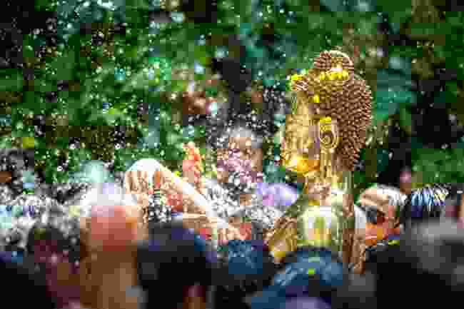 Revellers get drenched during Songkran Festival in Thailand (Shutterstock)