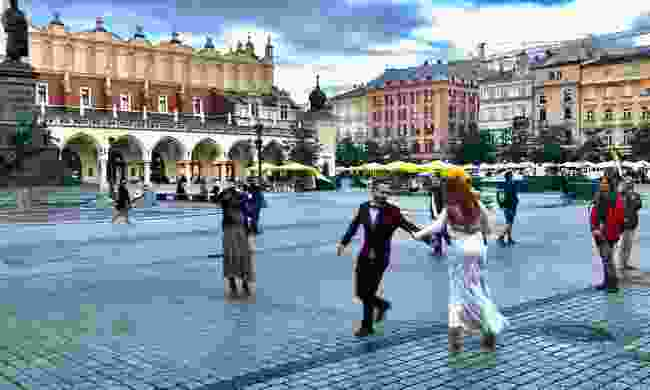 Bride and groom dancing in the Main Market Square (Peter Moore)