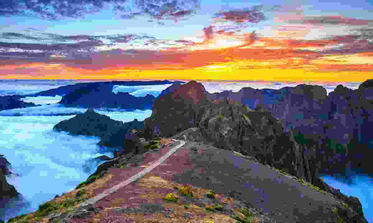 The clouds falling below the peaks of Madeira's highest peaks - Pico Ruivo, Pico do Areeiro and Pico das Torres (Shutterstock)