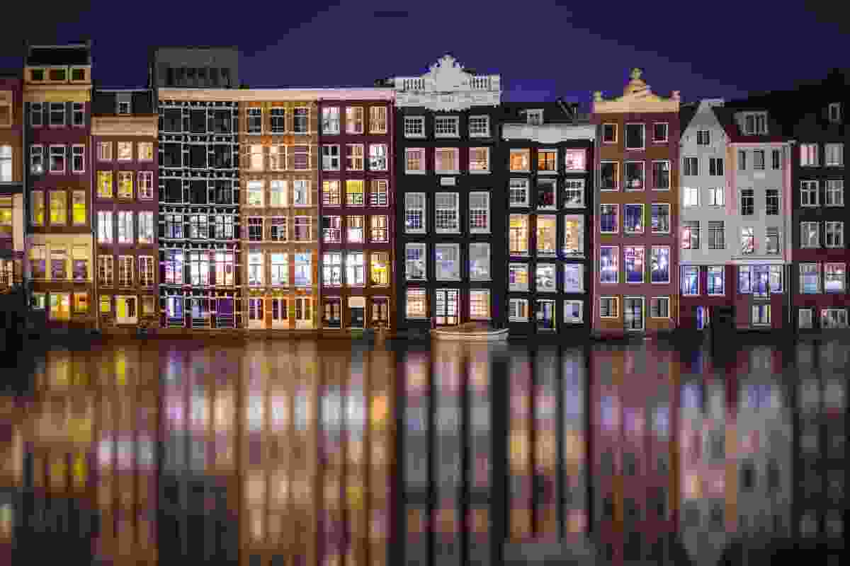 The illuminated windows of these houses in Amsterdam provide a colourful array of reflections on the canal below (Antony Zacharias)