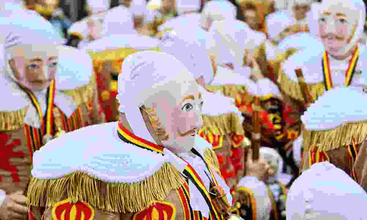 Gilles De Binche in traditional masks (Dreamstime)