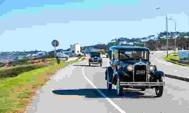 A parade of vintage cars entering the city of Punta del Este (Dreamstime)