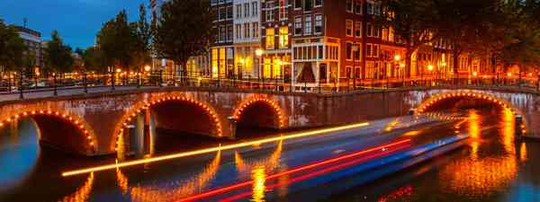 Night life The area around Amsterdam's Keizersgracht canal lights up as evening descends (Shutterstock)