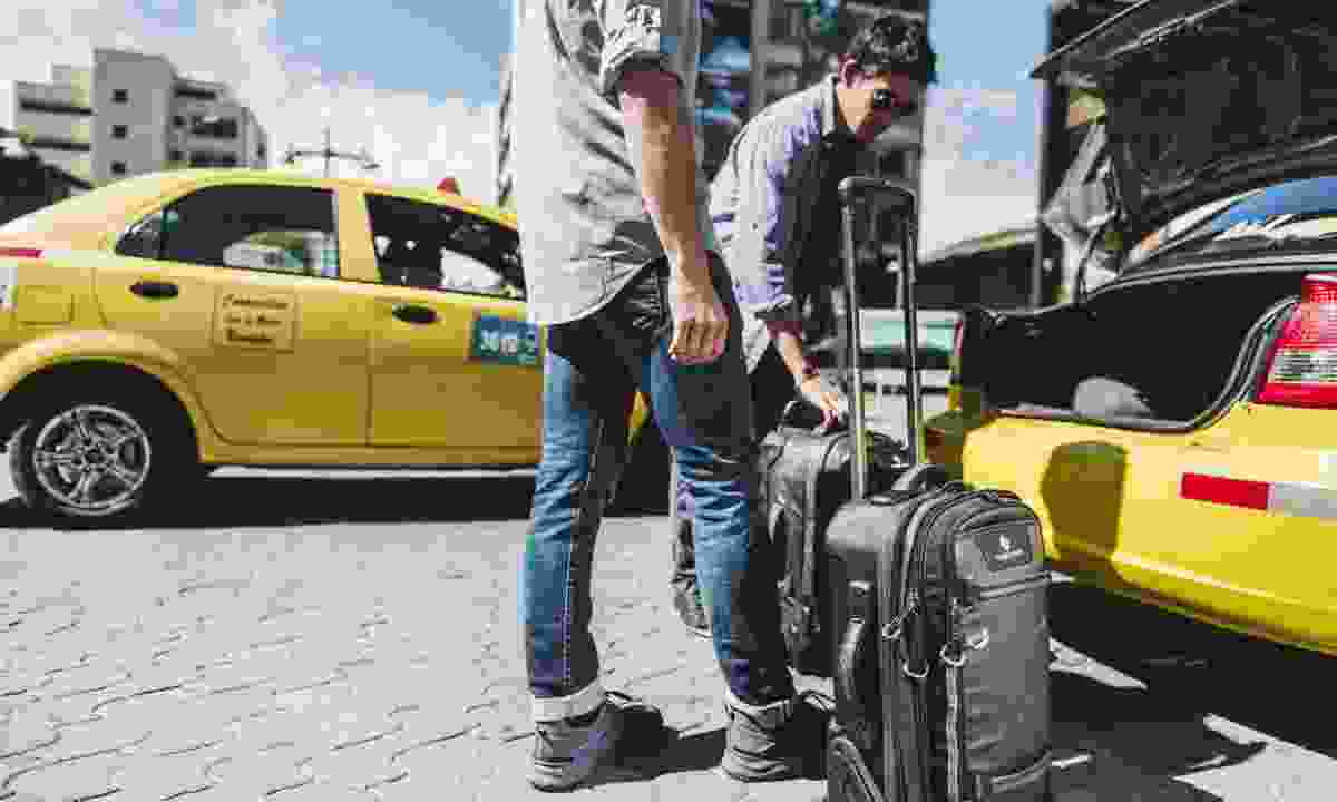 Taxi with morphus international carry-on (Eagle Creek)