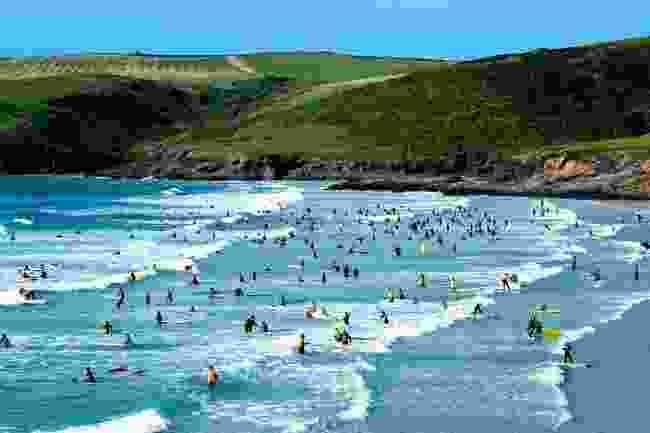 Surfing in Polzeath (Shutterstock)