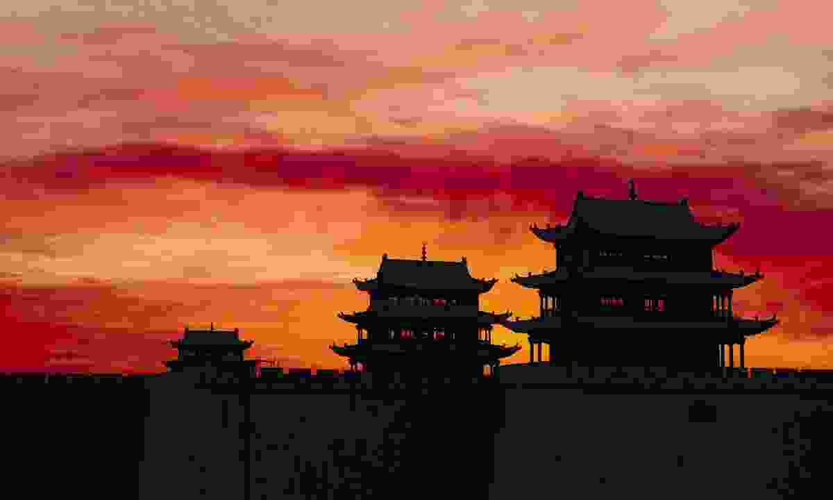 Silhouette of temples at sunset (Dreamstime)