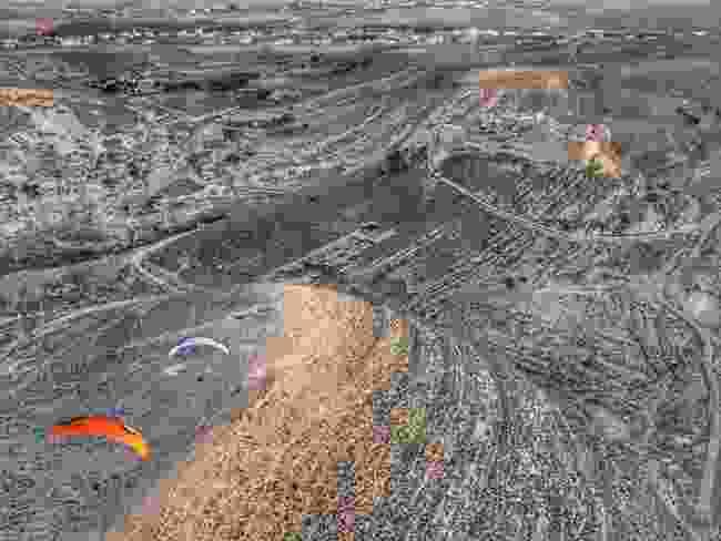 Paramotors flying towards the crusader-era fort at Shobuk in Jordan (Dan Burton)