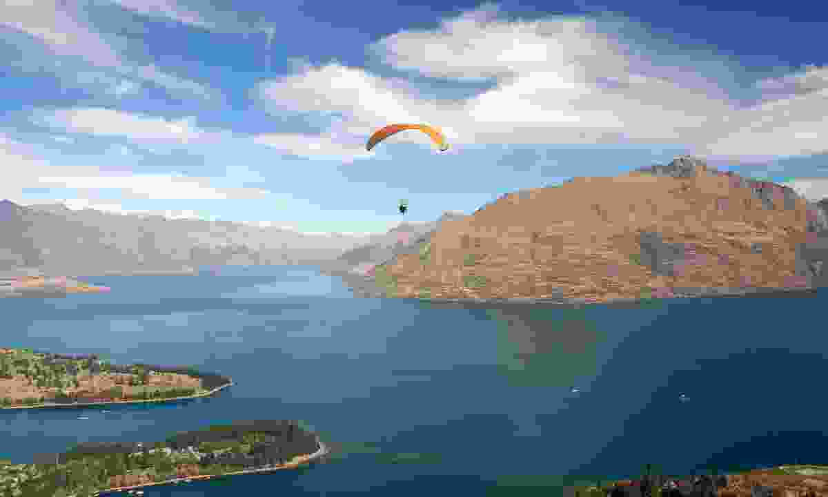 Gliding over a lake in the South Island (Dreamstime)