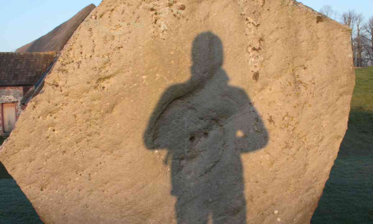 A mysterious shadow on an Avebury stone (Dreamstime)