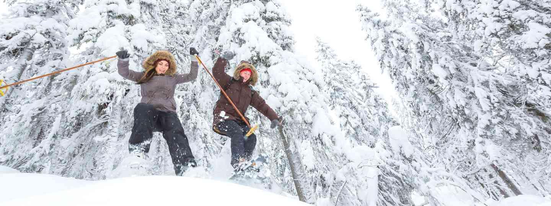 Girls snowshoeing in Europe (Dreamstime)