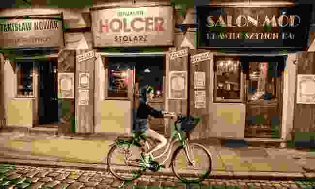 A girl cycling through Kazimierz (Poland Tourist Board)