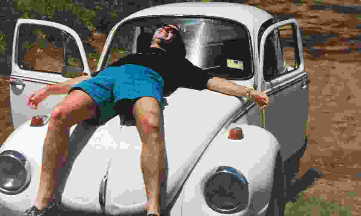 Paul takes a break on 'Snoozy Suzie', the VW Bug the pair drove across New Zealand until the head gasket blew