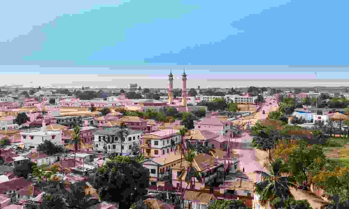 Explore lively Banjul by joining some locals for a run (Dreamstime)