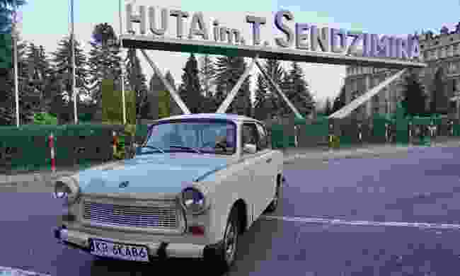 A Trabant outside the steel mill in Nowa Huta (Peter Moore)