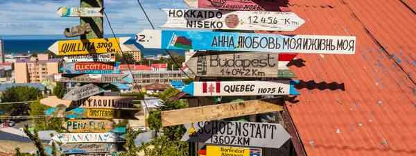 Punta Arenas, Chile mileage sign (Shutterstock)