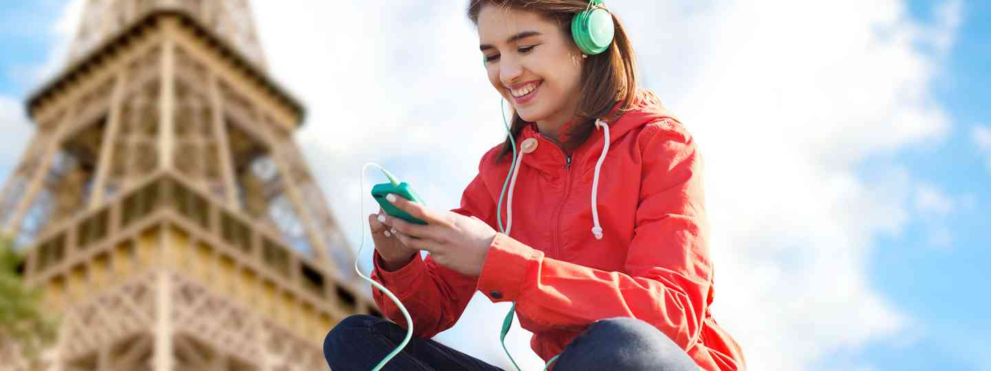 Woman listening to podcast (Shutterstock)