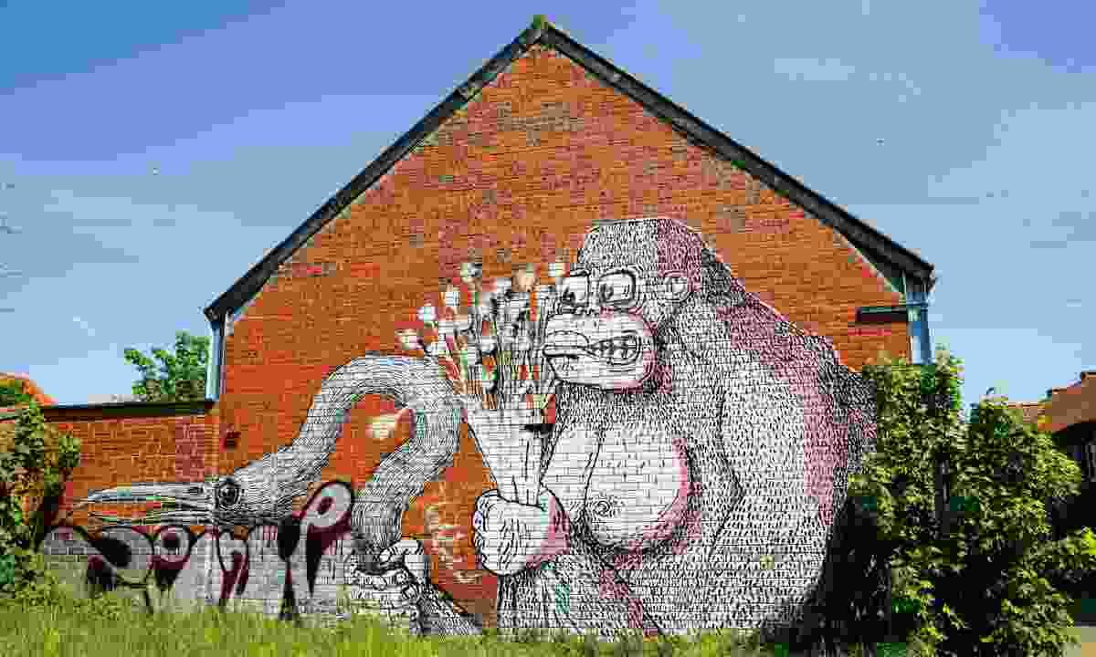 Graffitied streets in Doel display artist Roa's murals (Dreamstime)