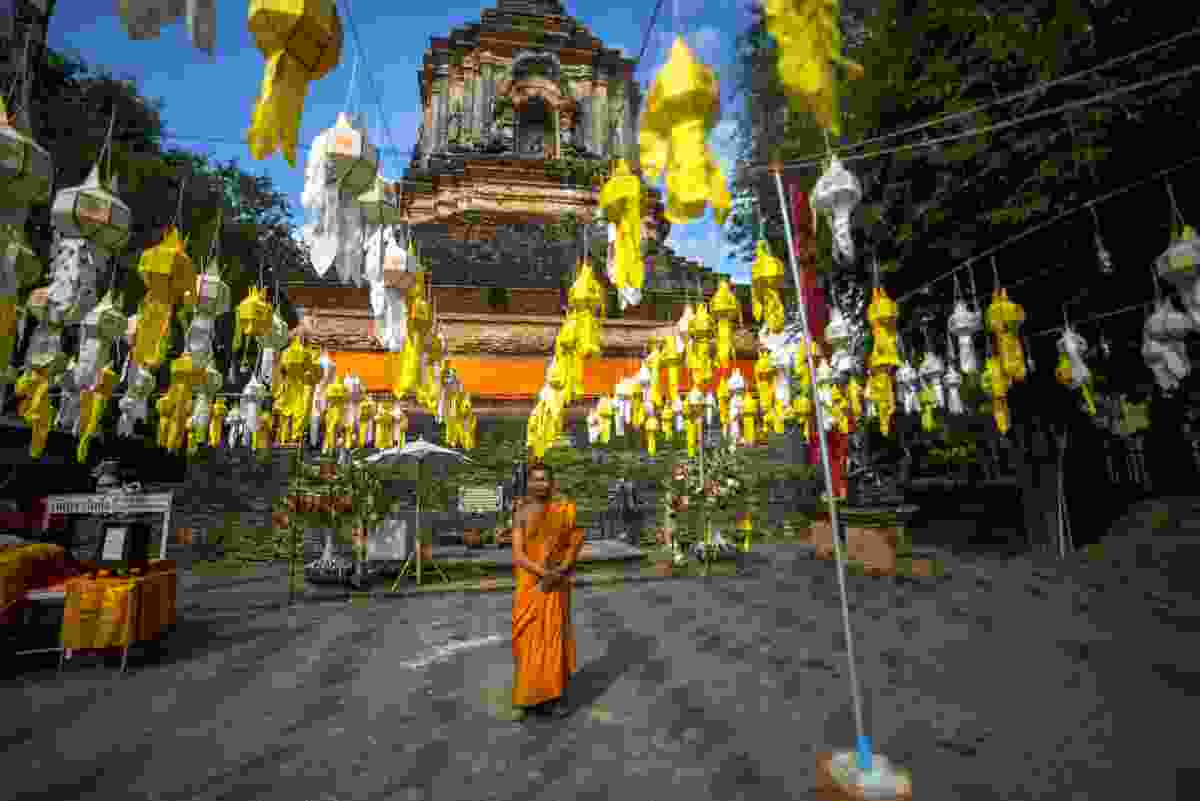 A monk at Wat Lok Molee temple, decorated with colourful lanterns (Sanghamitra Sarkar)