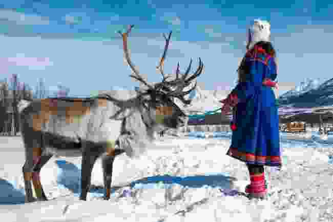 A Sami woman wearing traditional dress in northern Norway (Shutterstock)