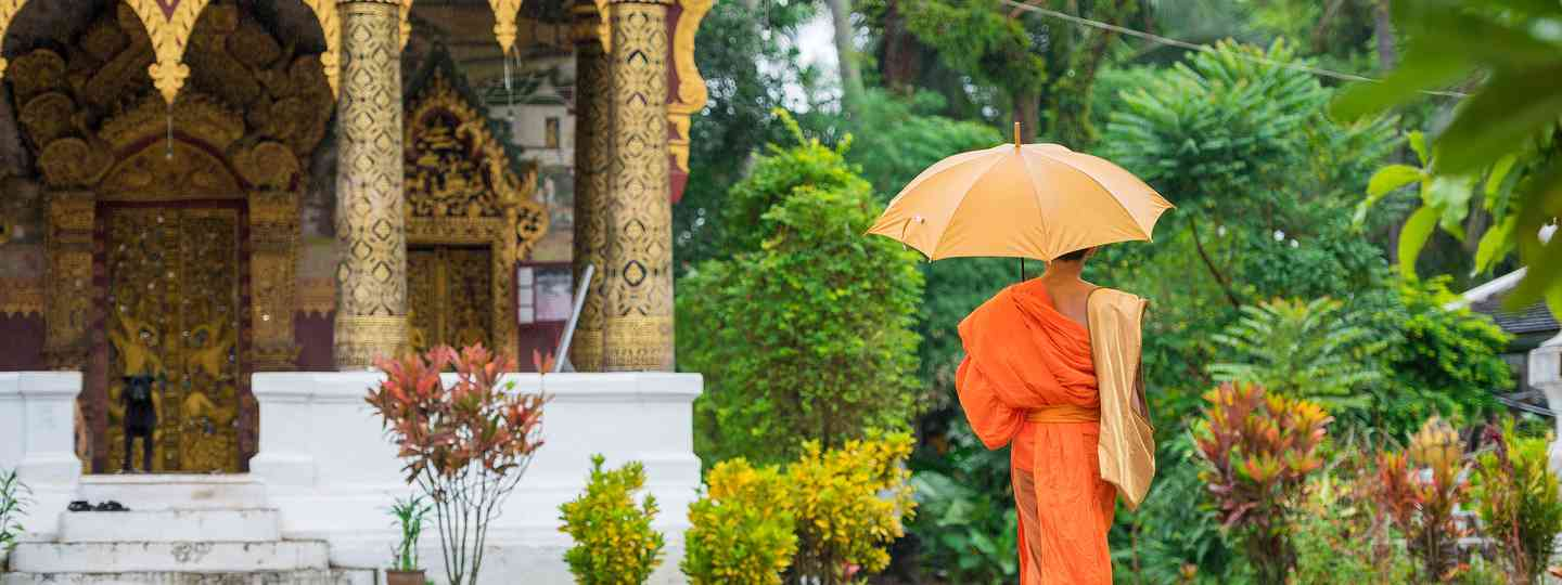 A monk outside a temple in Luang Prabang (Shutterstock)