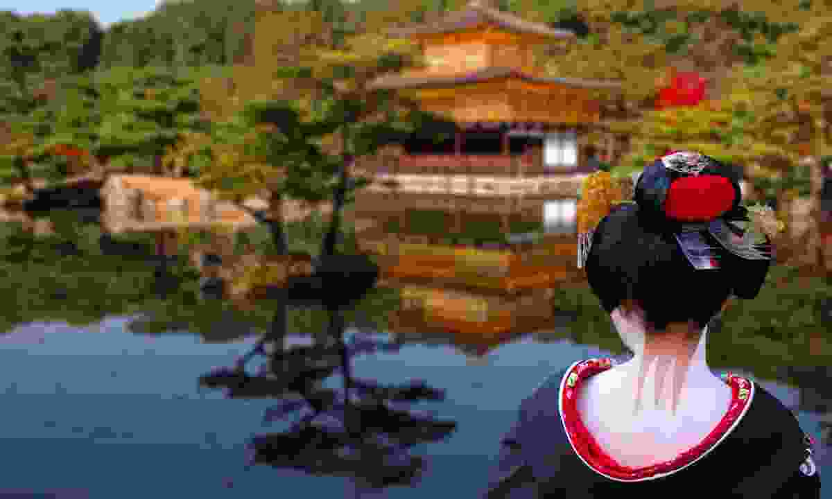 Geisha looking towards the Golden Temple in Kyoto (Dreamstime)