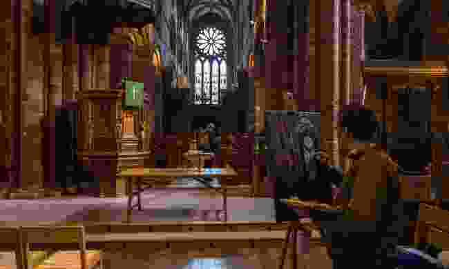 Artist painting inside St Magnus Cathedral (Shutterstock)