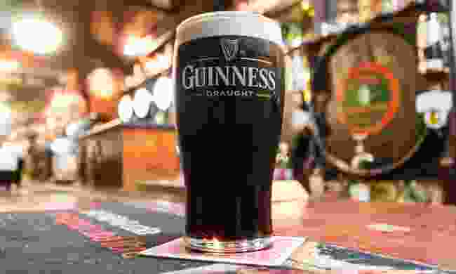A freshly pulled pint of Guinness in a pub in Northern Ireland (Shutterstock)