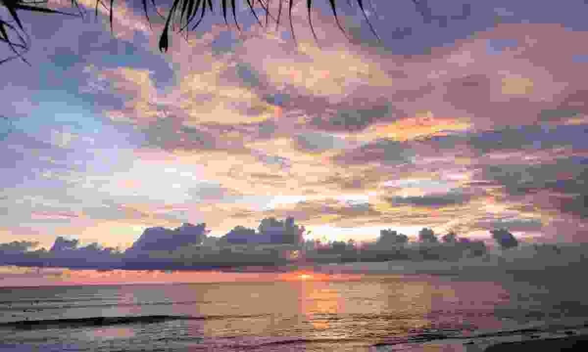 A stunning sunset over sunset Batu Bolong beach (Dreamstime)