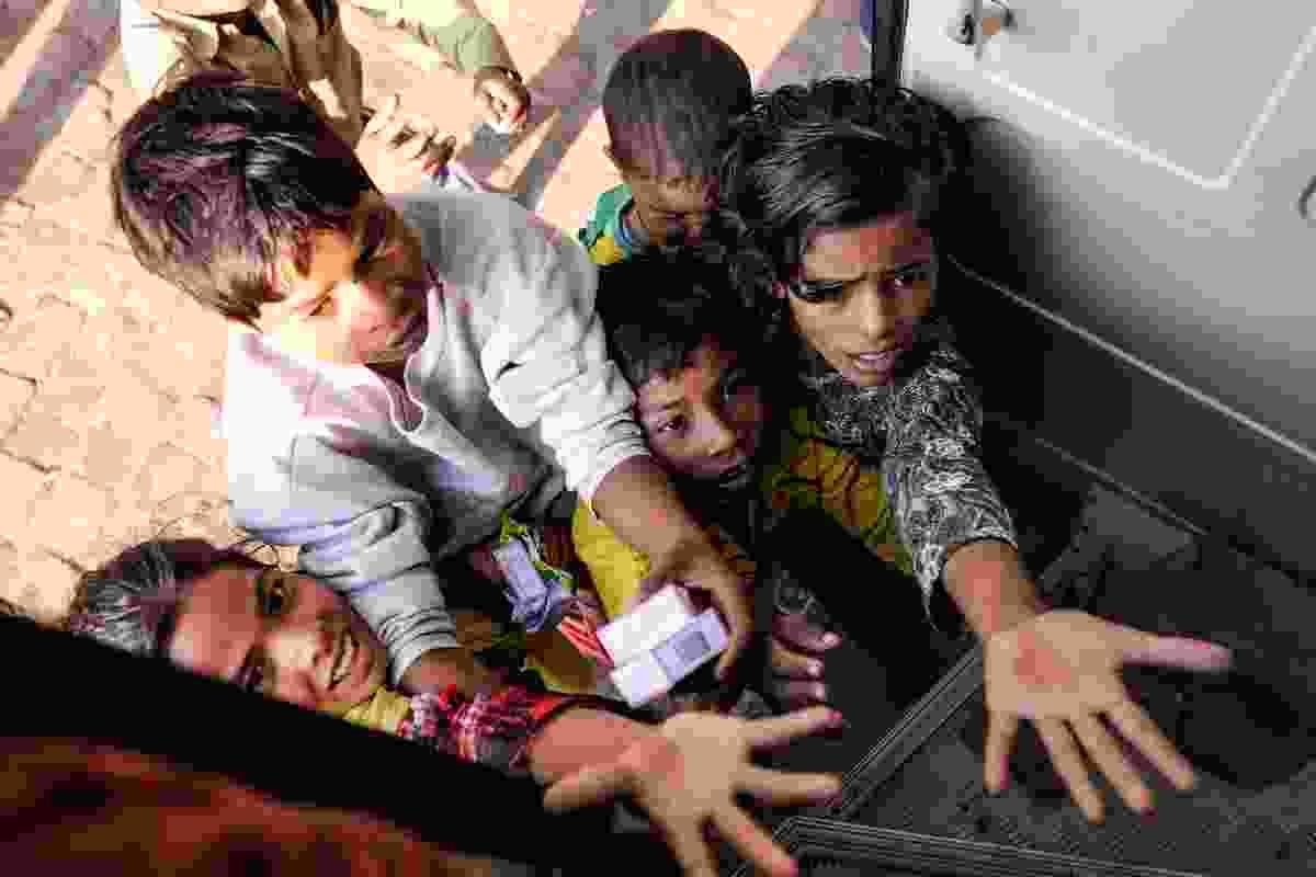 Beggars in Delhi, India (Shutterstock)