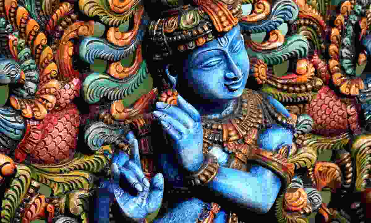 Wooden statue of Lord Krishna (Dreamstime)