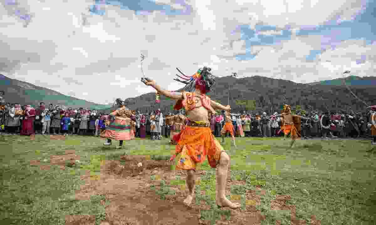 Tsechu mask dancing in Bhutan (Dreamstime)