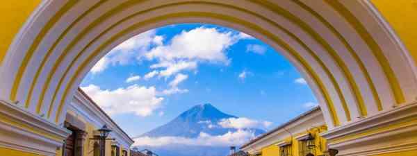 The Santa Catalina Arch in Antigua, Guatemala  with Agua Volcano in the background  (Shutterstock)