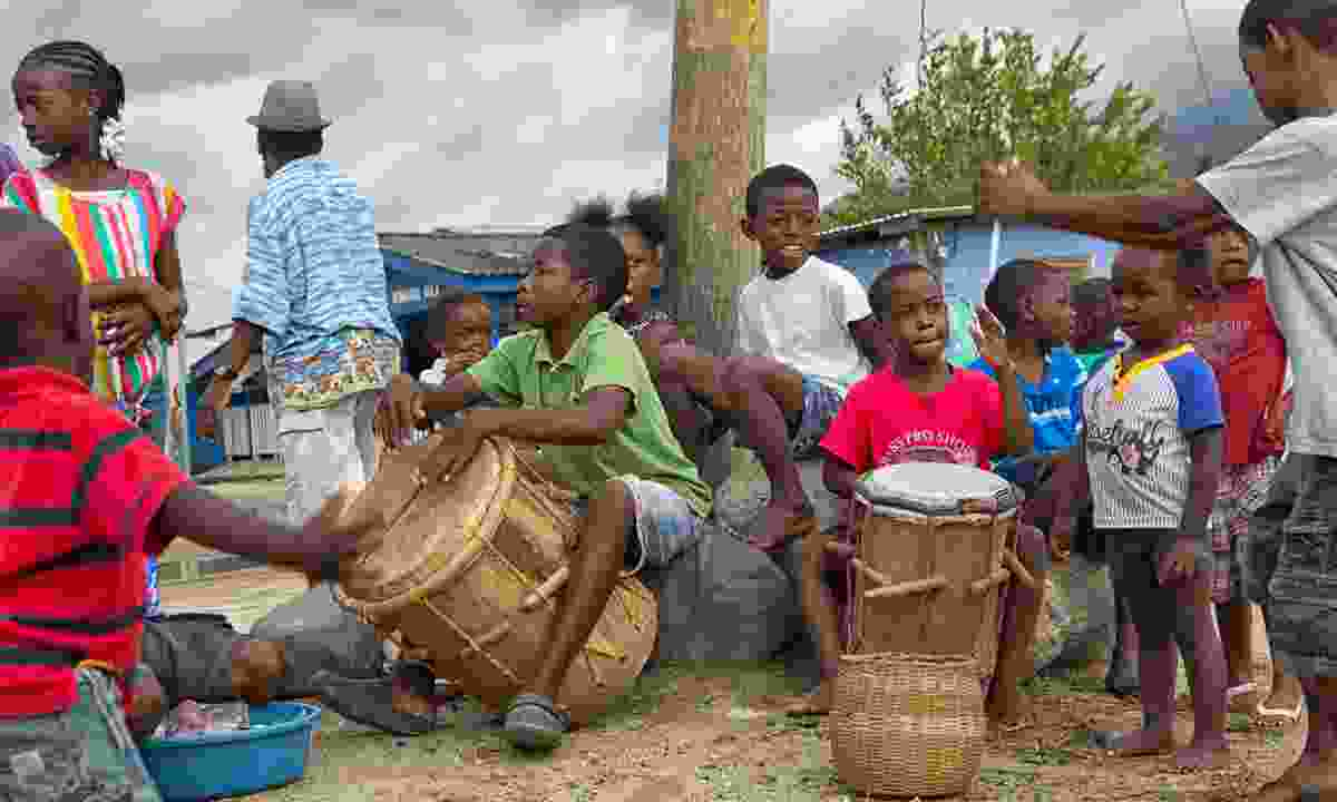 Young Garifuna boys playing traditional drums in Honduras (Shutterstock)