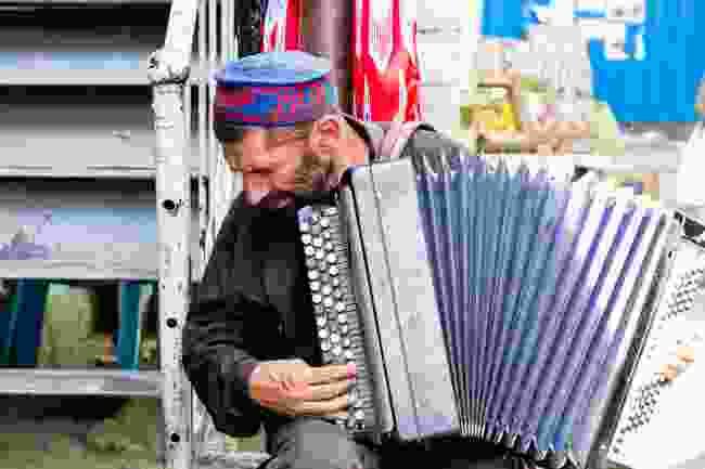 A street musician in Khorog, Tajikistan (Dreamstime)