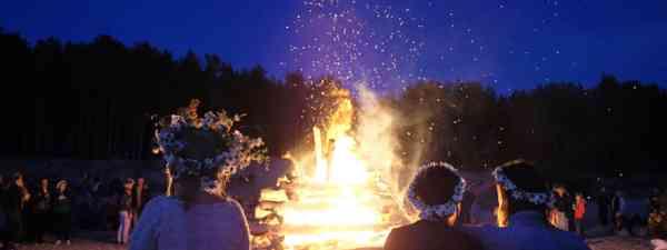 A midsummer bonfire for summer solstice in Latvia (Dreamstime)