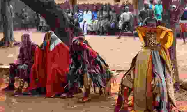 Masked participants of the Egungun Ceremony, Benin (Shutterstock)